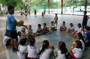 Explaining Futsal to Kids of A Million Voices Foundation