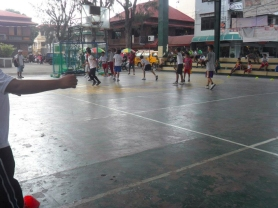 Kids of Marinduque playing futsal in their plaza.